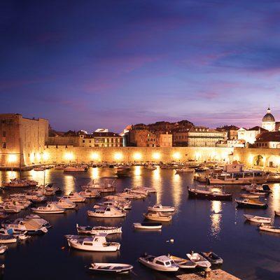 Croatia, Dubrovnik, boats moored in Old Harbor at dusk